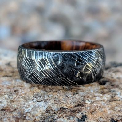 Damascus Steel Mens Wedding Band With Hammered Ironwood Sleeve