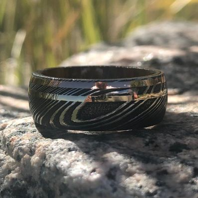 8mm Damascus Steel Ring with Dual 14k Yellow Gold & Rose Gold Off Center Grooves and a Arizona Ironwood Sleeve